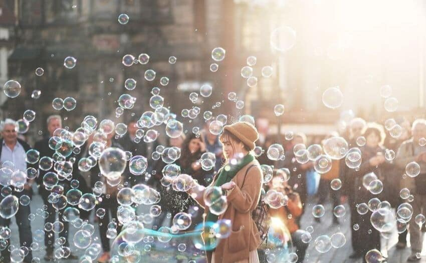 a girl standing in a sea of bubbles